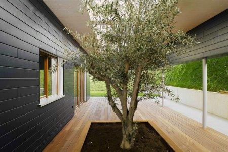 Навесной вентилируемый фасад загородного дома